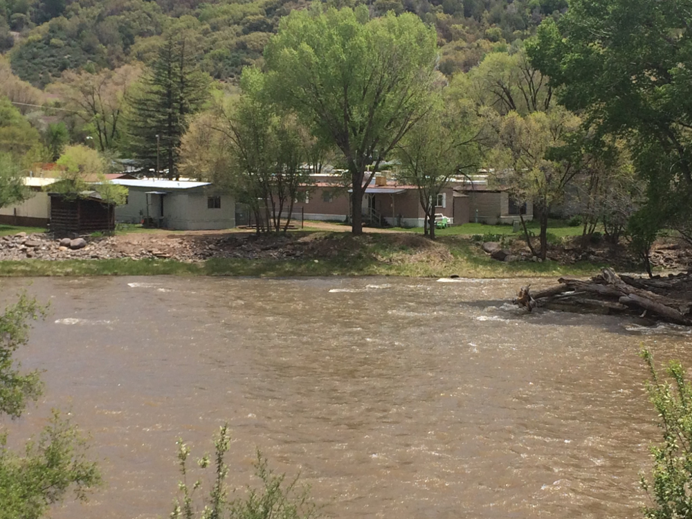 View across the Animas River of some small houses in Durango, CO